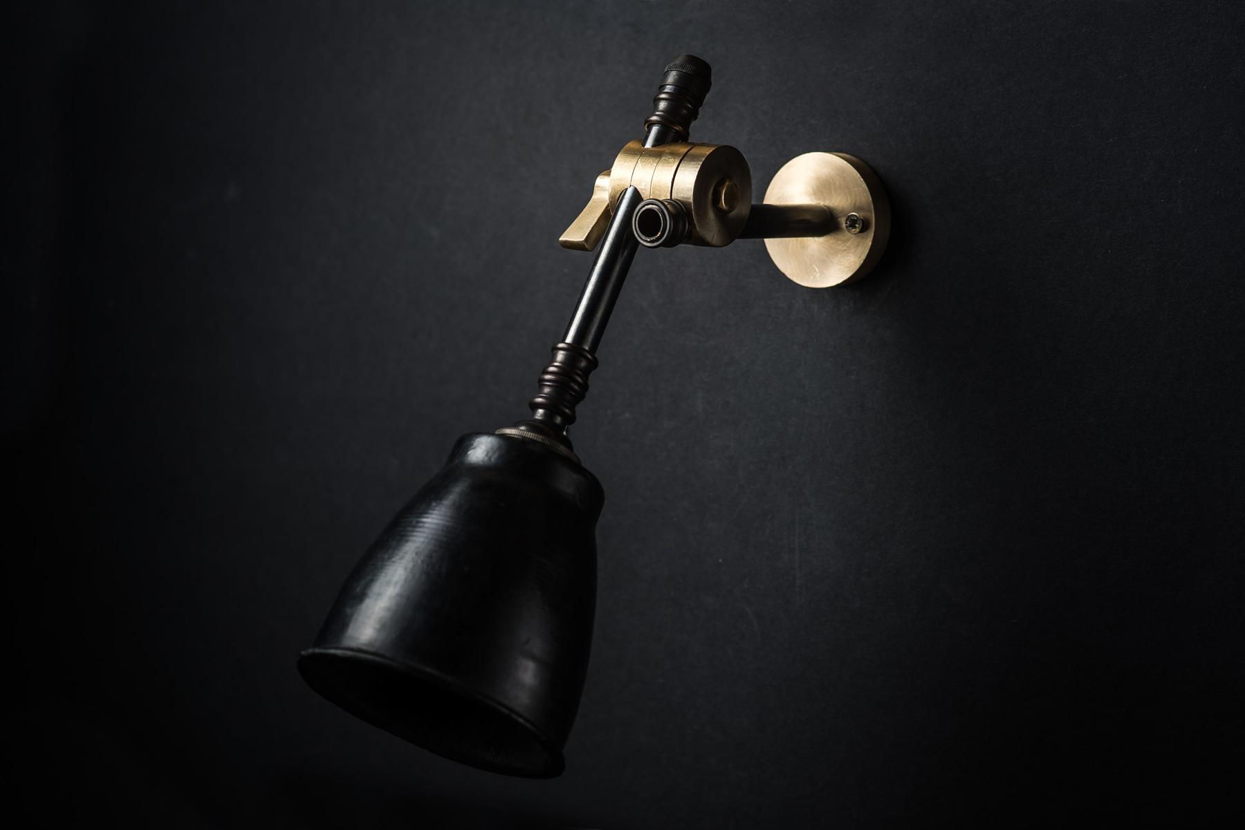 brass bronze and vulcan black stone adjustable wall light 02.jpg