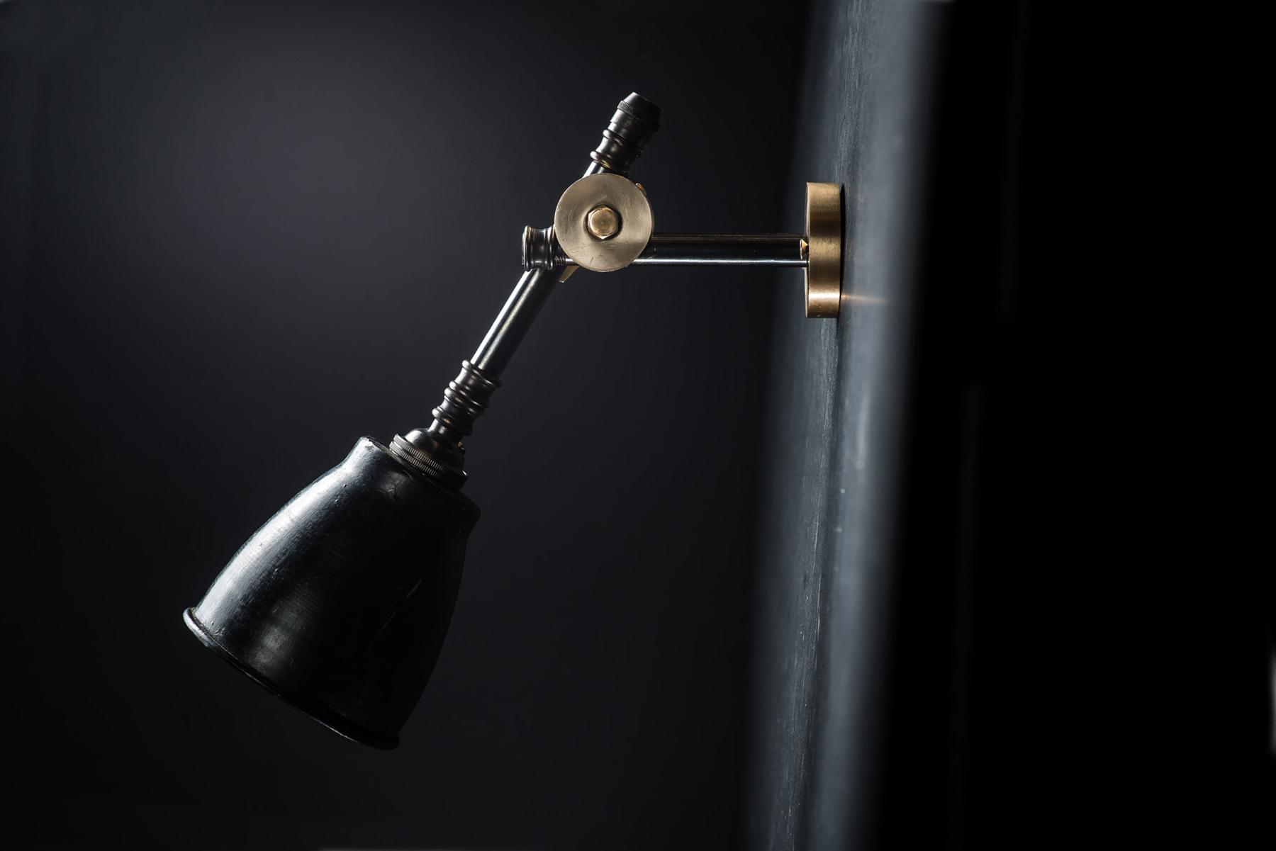 brass bronze and vulcan black stone adjustable wall light 06.jpg