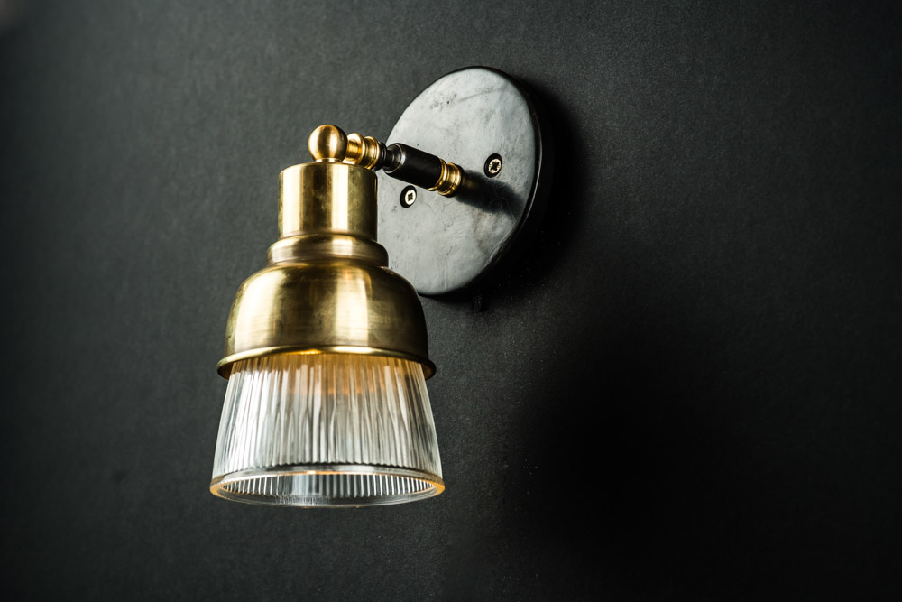 Spun Brass and Holophane Glass Adjustable Armed Wall Light