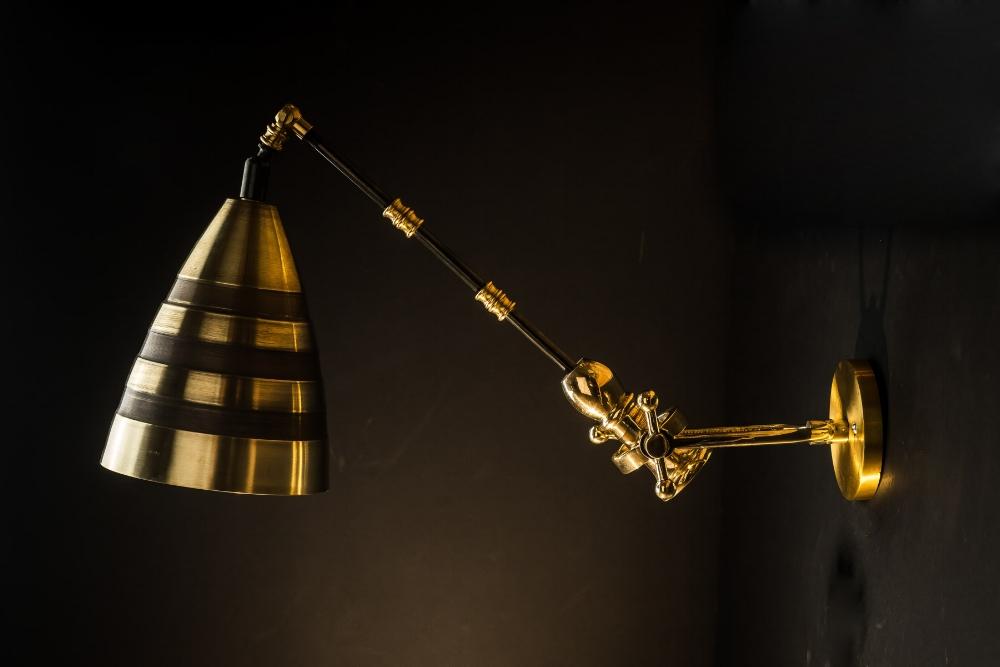 Adjustable brass and bronze 'hornet' wall light.jpg