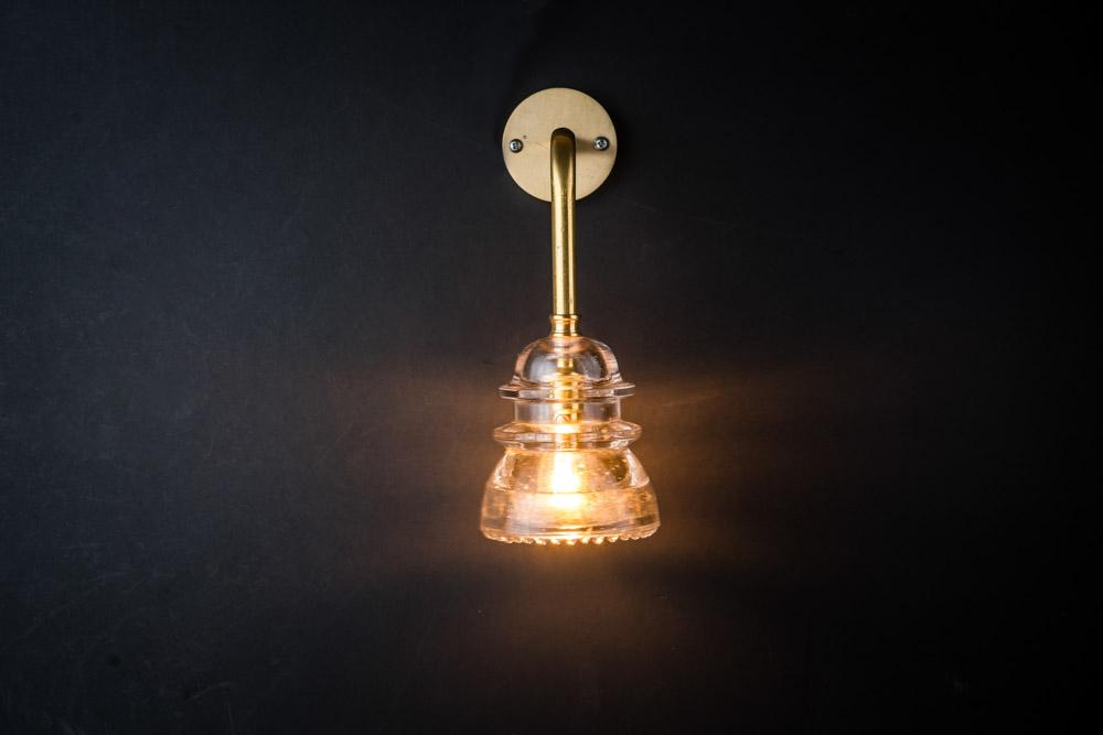 Brass armed insulator glass wall light.jpg