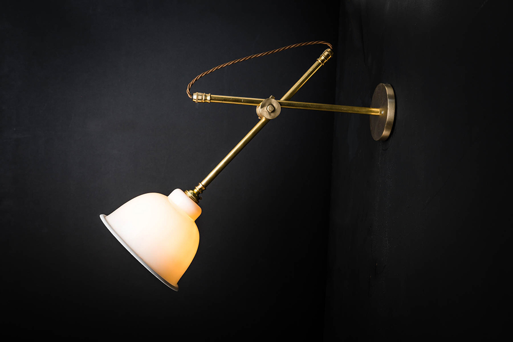 BRASS AND BONE CHINA SLIDER WALL LIGHT.jpg