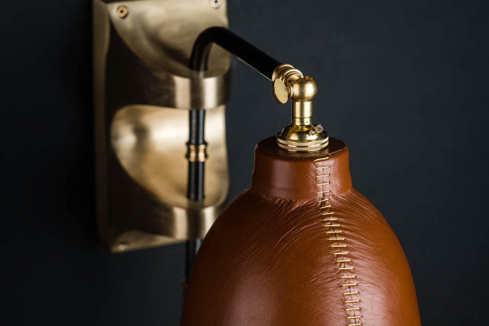 Adjustable brass and leather covered wall light 02.jpg