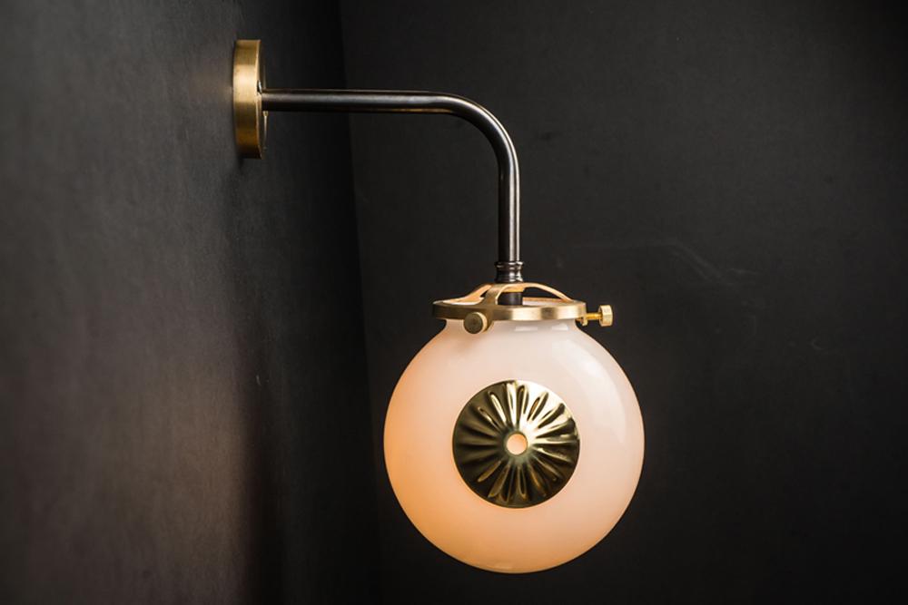 brass, bronze and opaline globe wall light.jpg