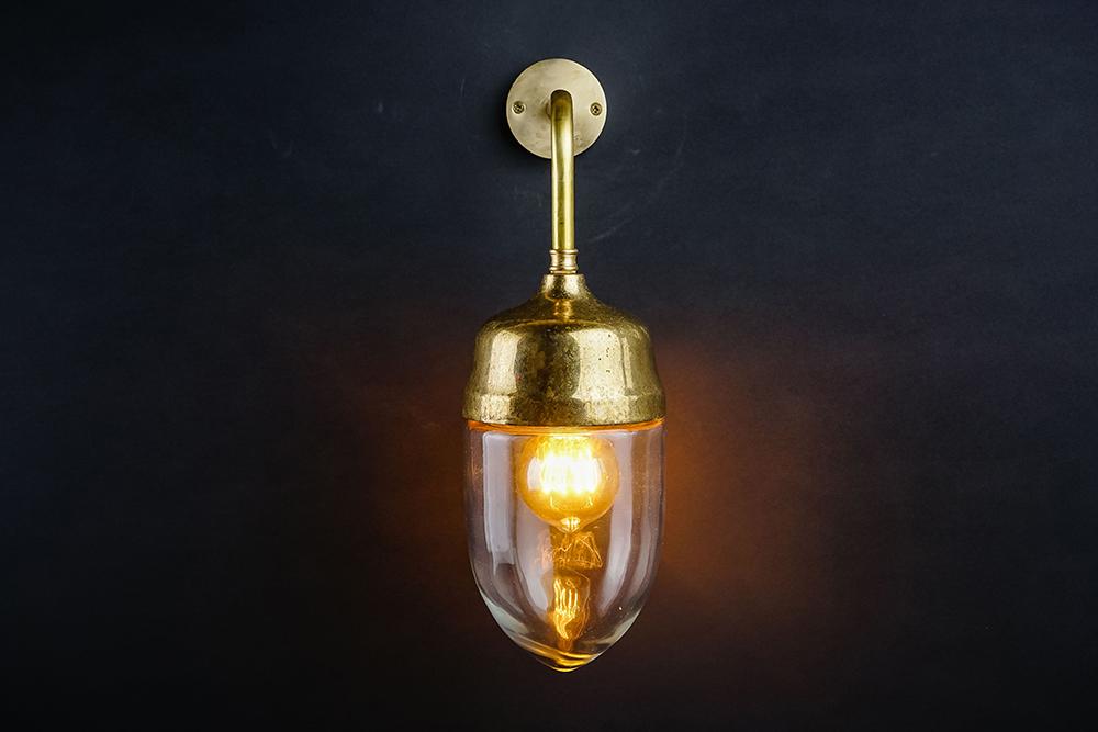 Aged brass and glass teardrop wall light .jpg