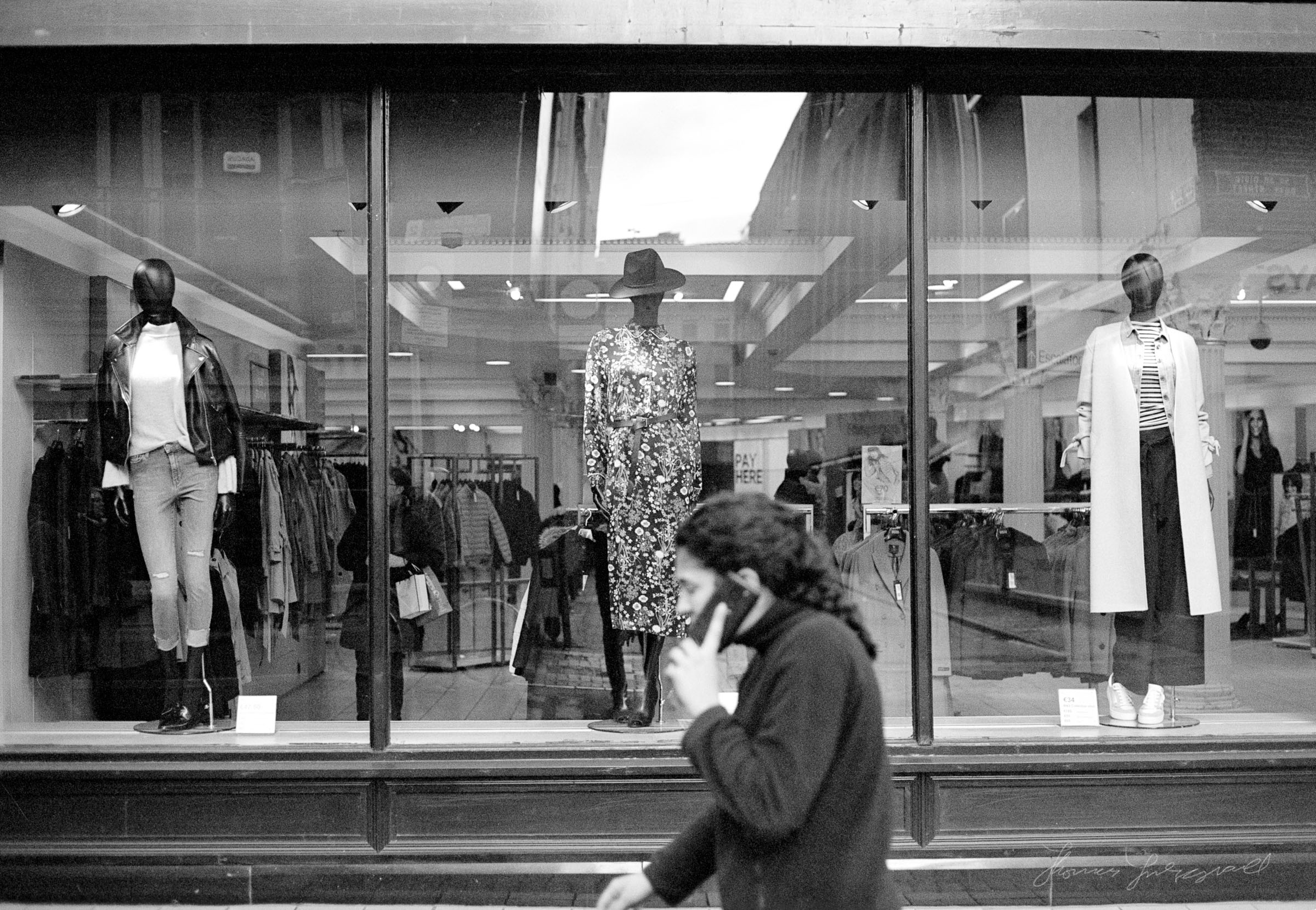 Person walking by Mannequins in a Window - Streets of Dublin - Dublin on Film