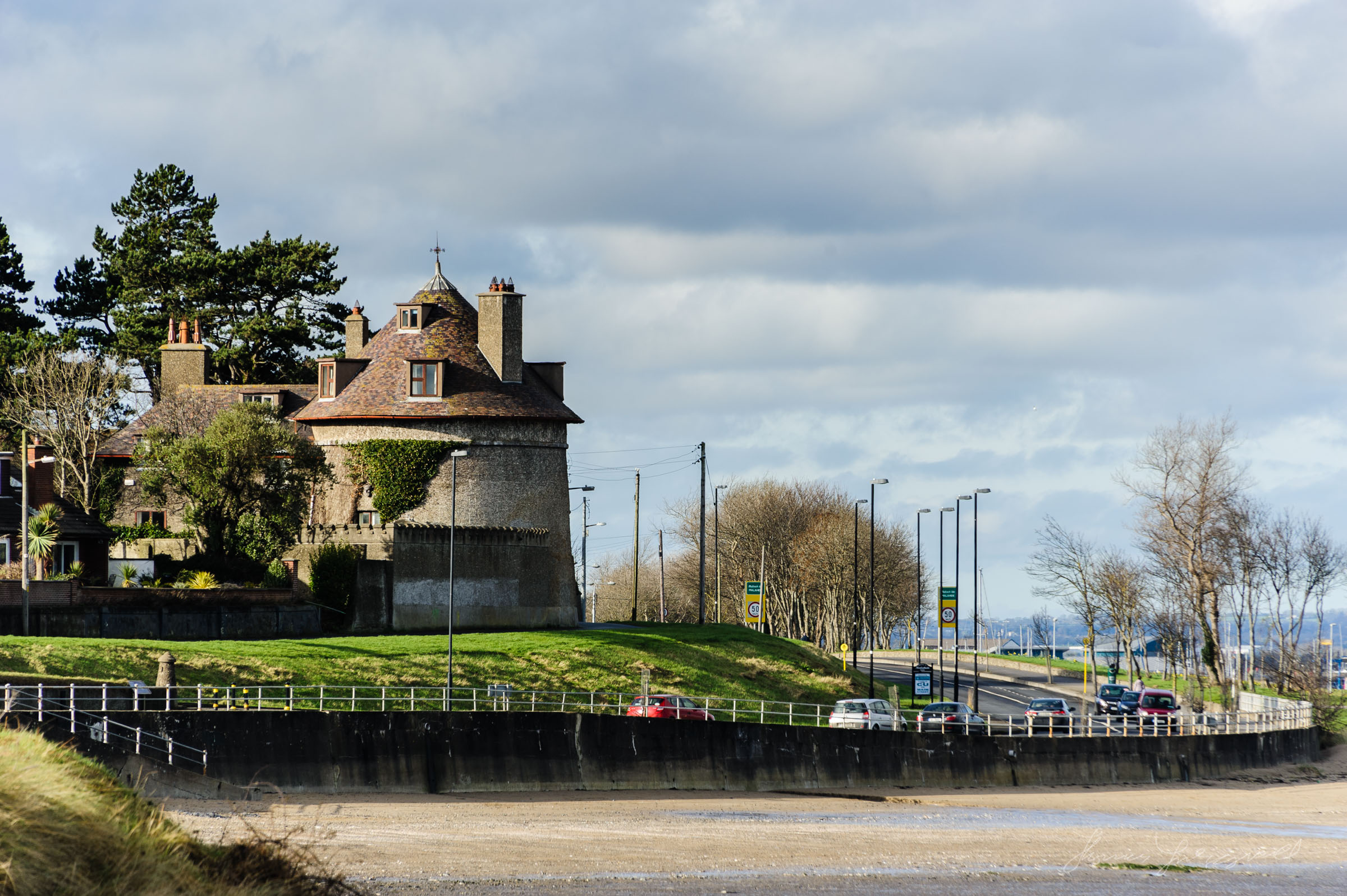 Malahide coast road and old building