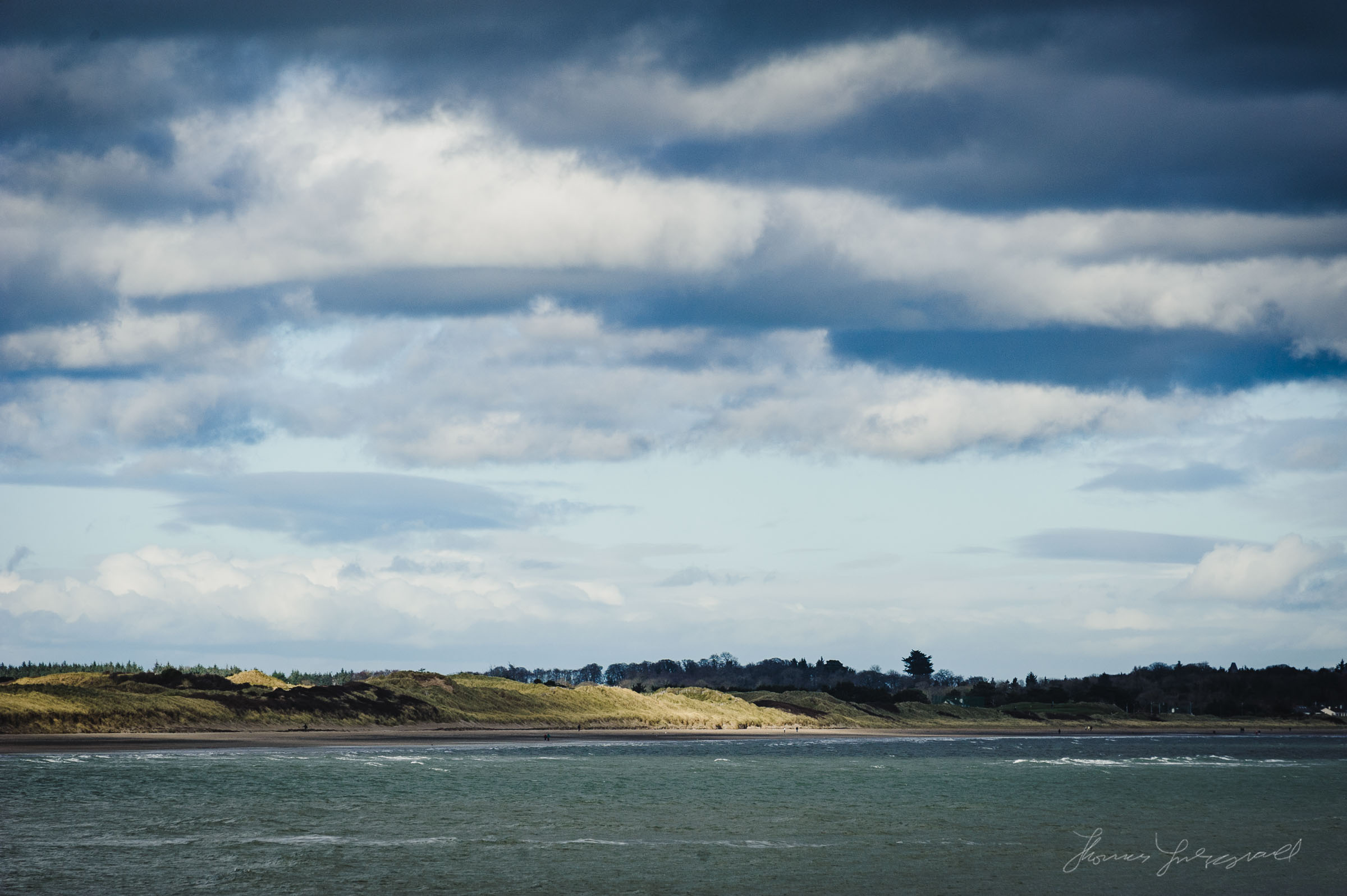 Patches of Sun on the beach at Malahide