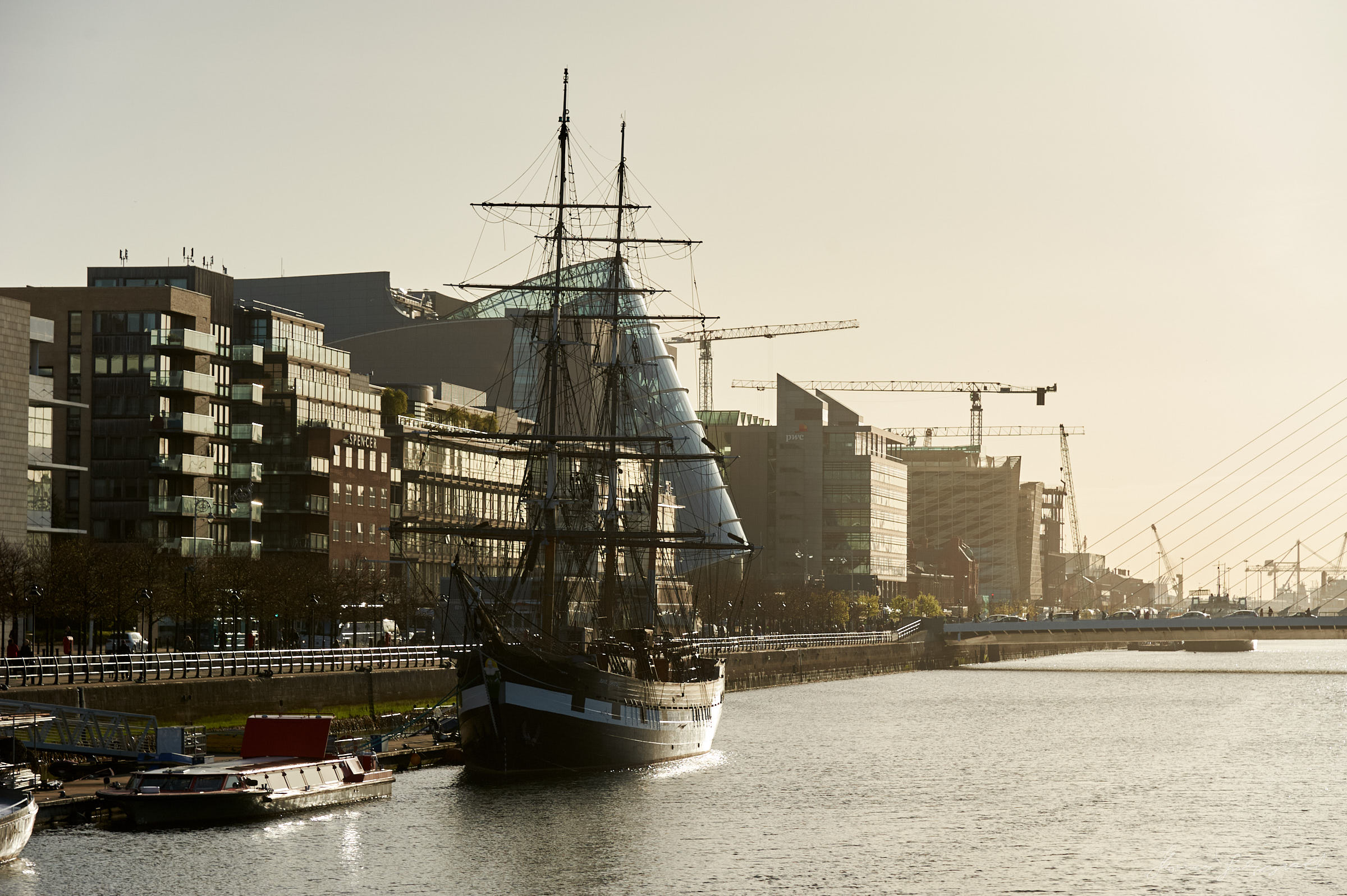 Ship moored by the walls of the river Liffey in Dublin