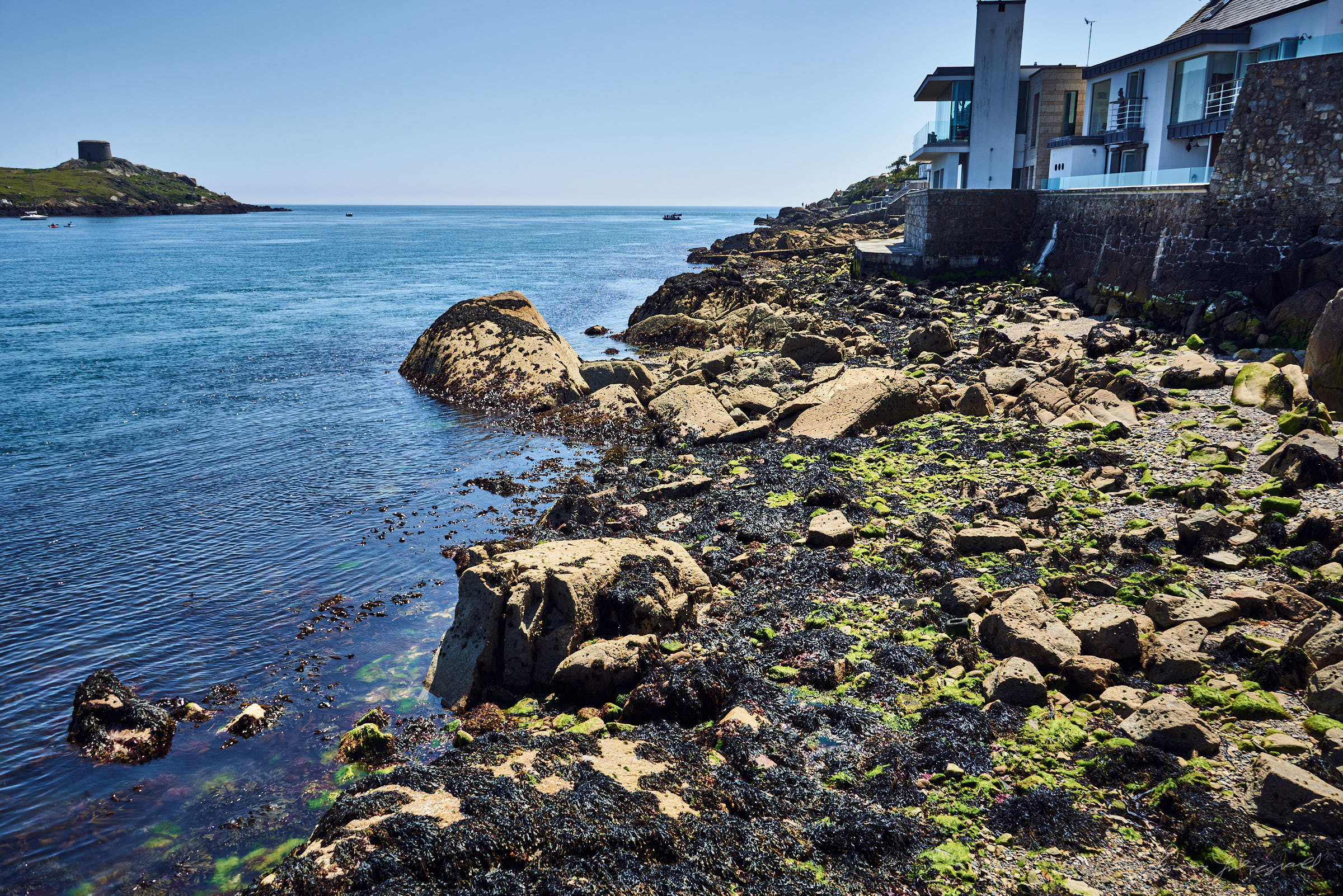 Rocks on the shore at Dalkey in Dublin on a sunny summers day
