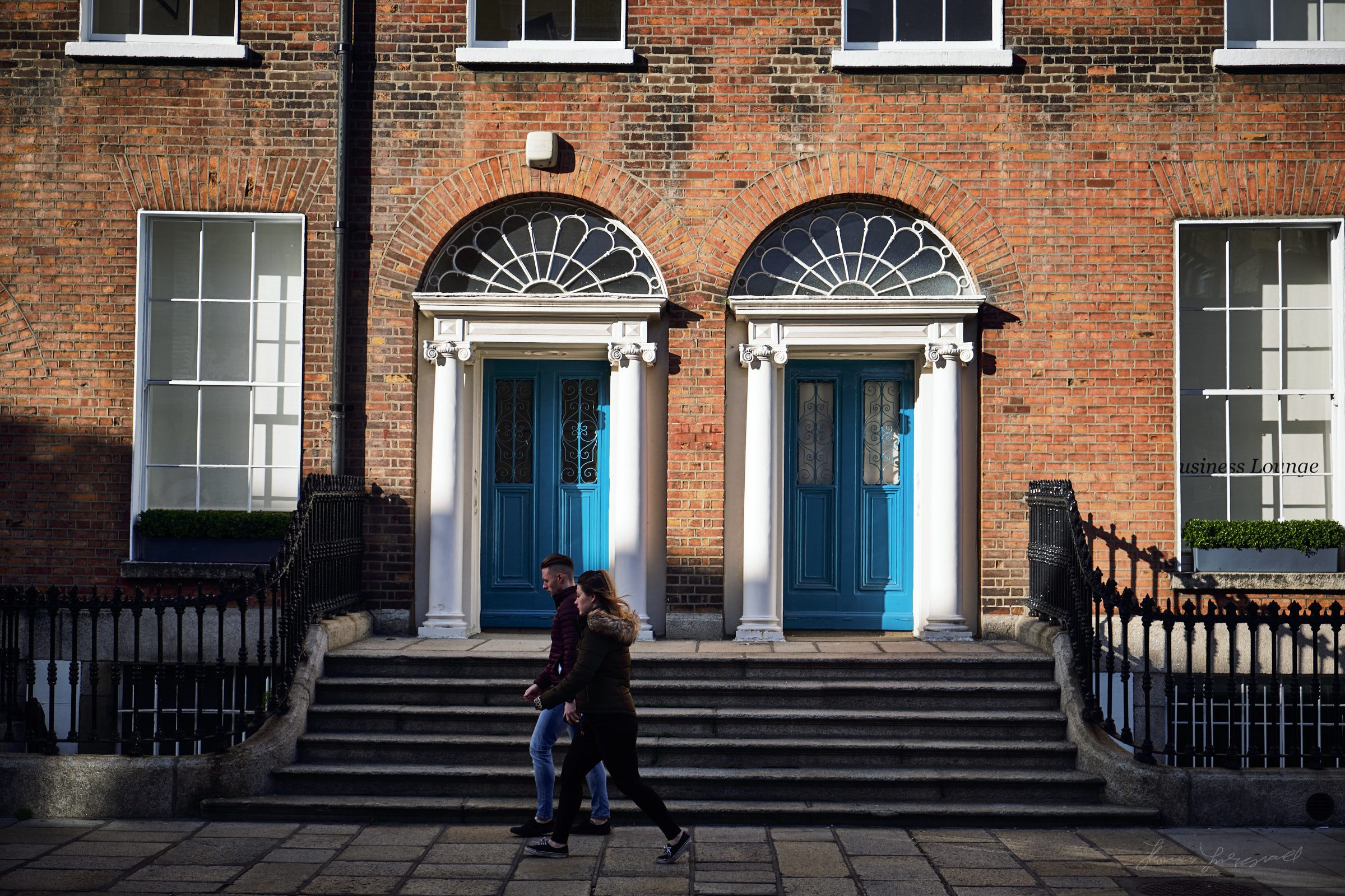 Blue doors and passers by in Dublin