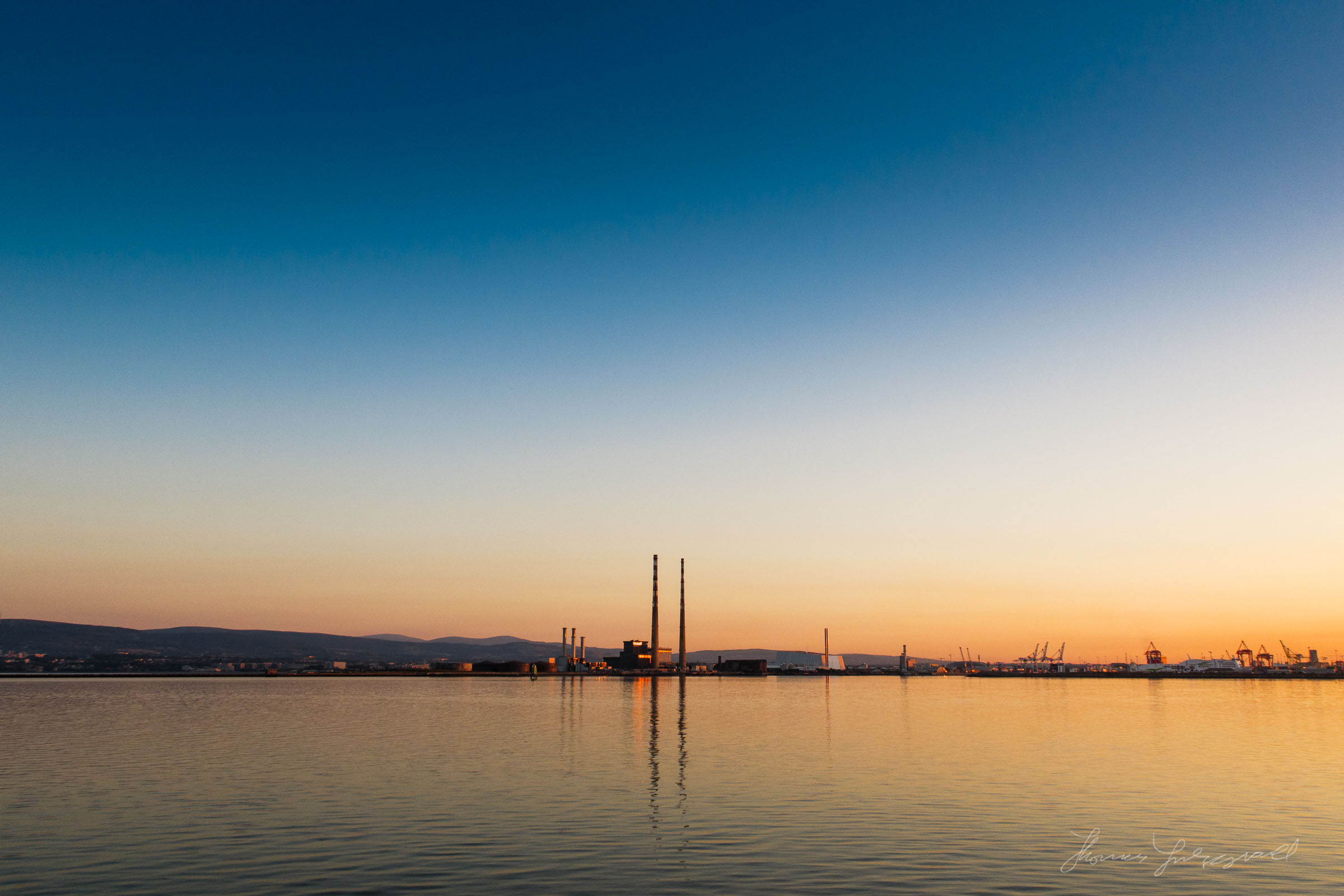 Sunset over Dublin's iconic Poolbeg Towers