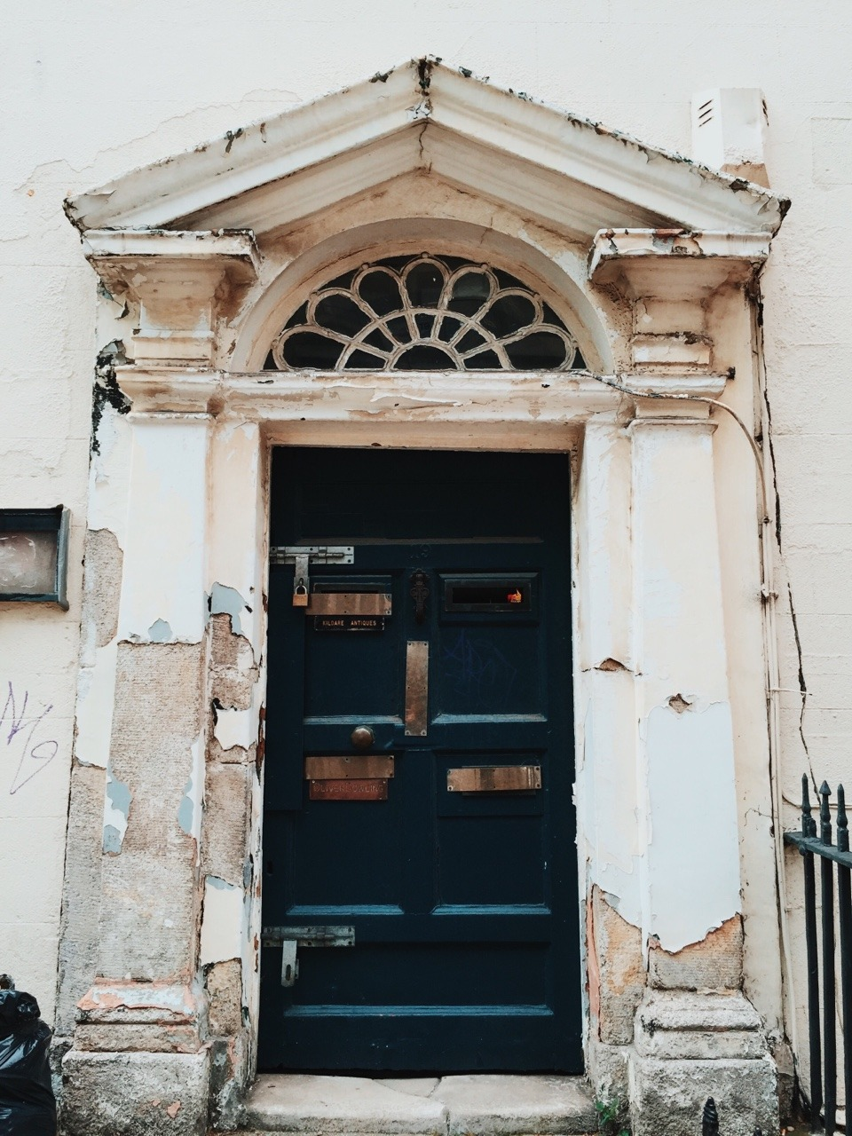 fxgeek :     Another old Dublin doorway. I love the texture of these old worn out doorways, where you can see the layers of old paint