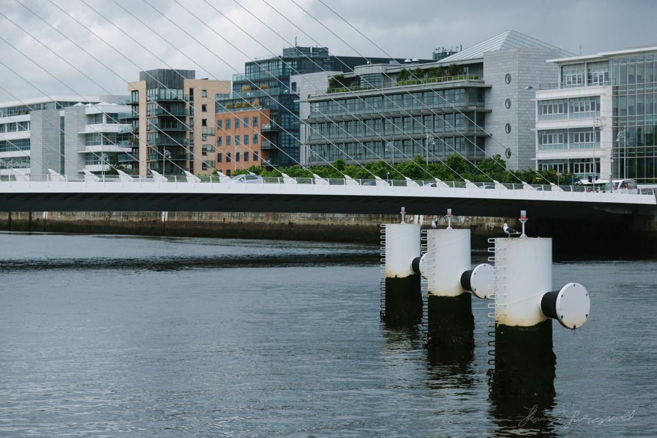 Channel markers beside the Beckett Bridge