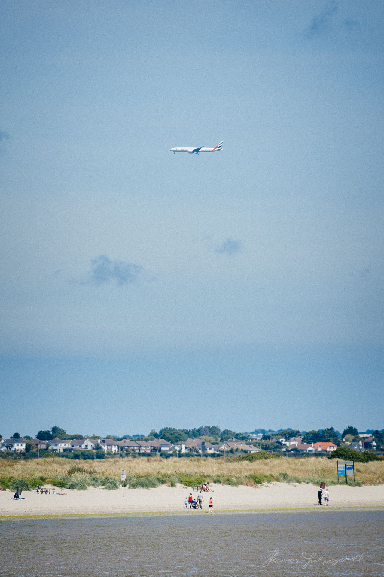 Plane coming in to land at Dublin airport over Dollymount Strand