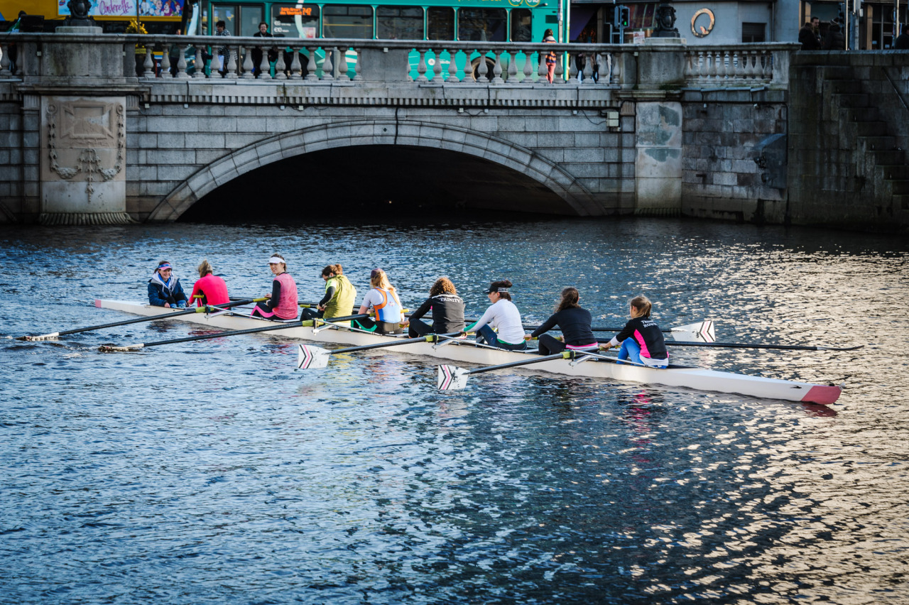 A group of rowers paddle along the liffey by O'Connell bridge during the summer of 2012