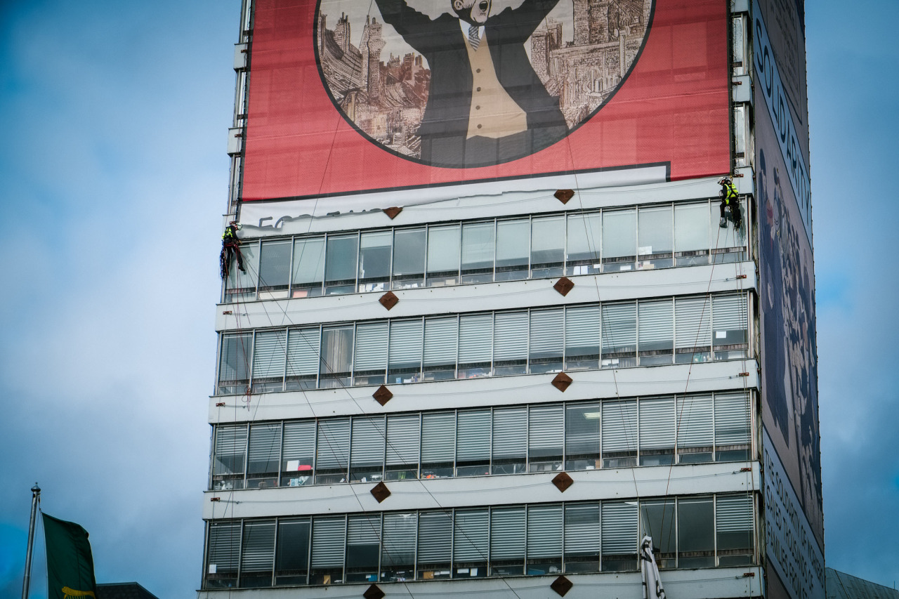 Workmen taking down the banner on Liberty Hall