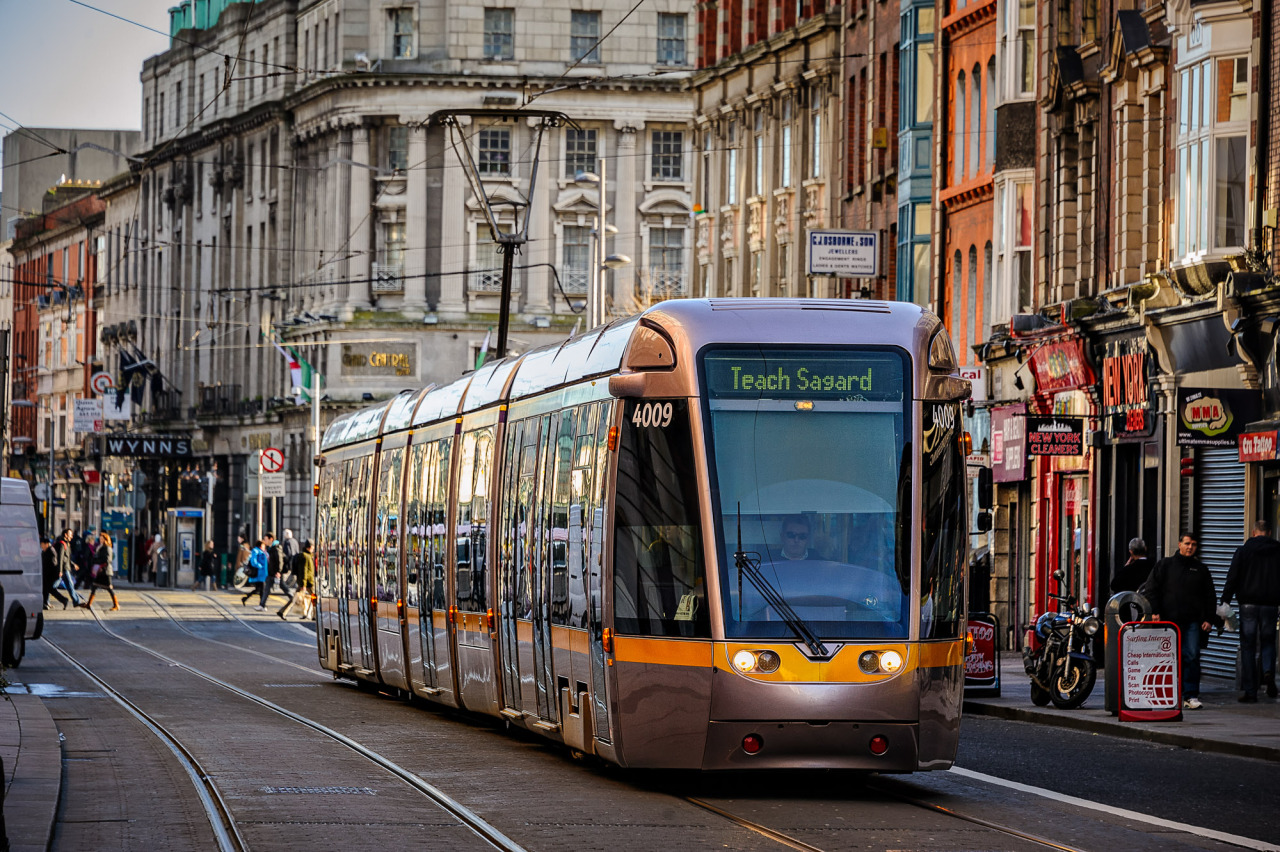 The Red Line Luas heads down Abbey Street on a sunny Spring day.