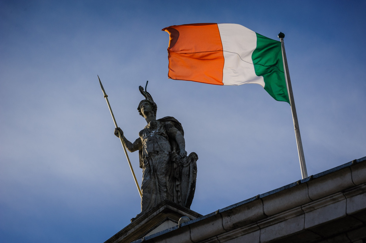 The Irish Flag flying high over the GPO beside the statue on the top of the building.
