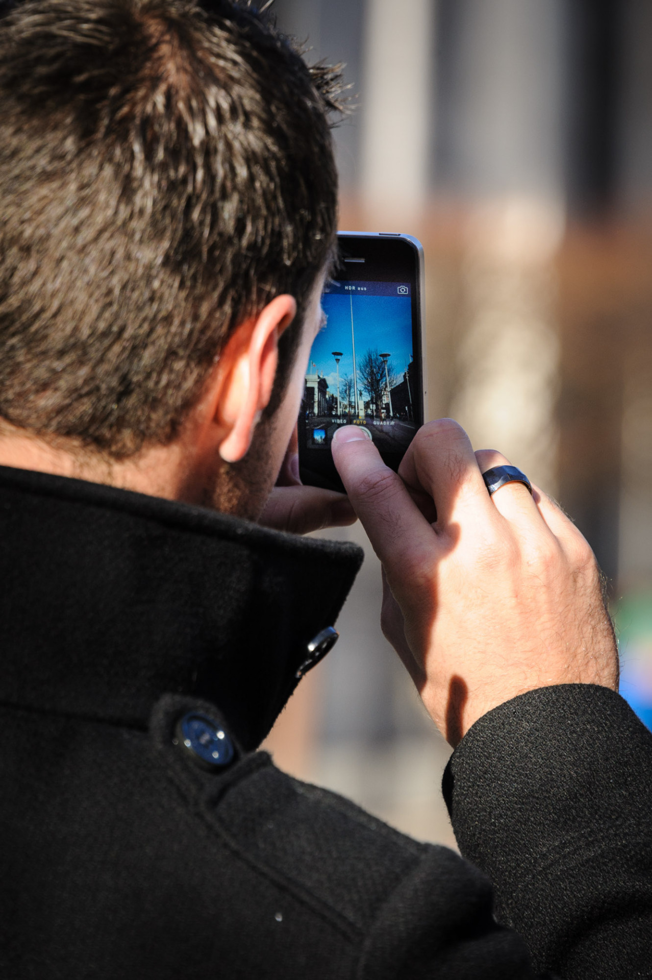 A photo of a guy taking a Photo of the Spire on O'Connell Street!