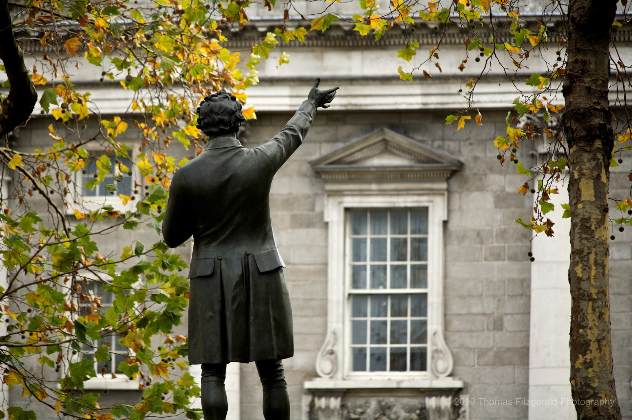 Statue in front of Trinity College