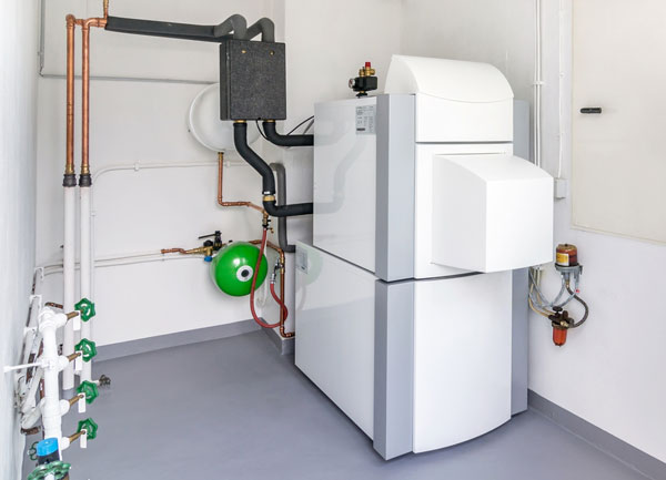 A domestic household boiler room with a new modern heating oil hot water system