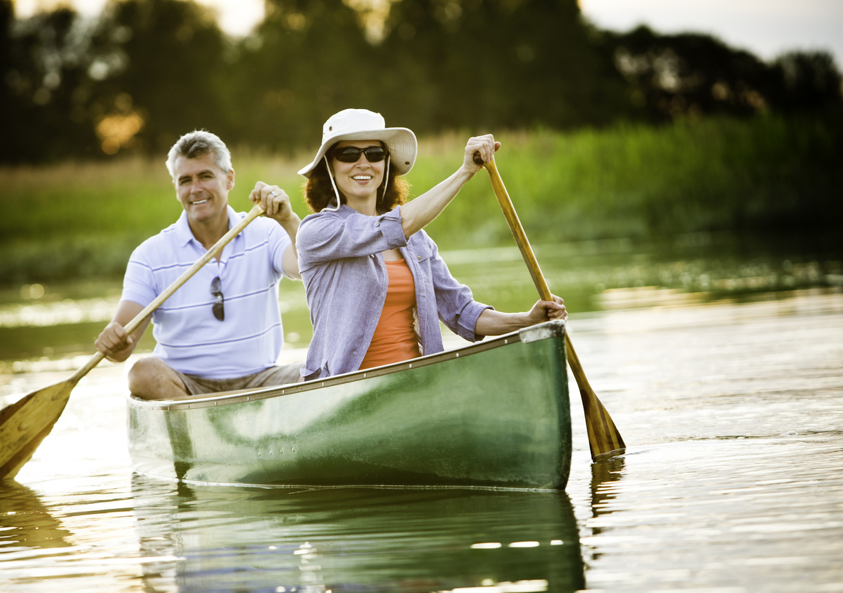 mature couple canoeing.jpg
