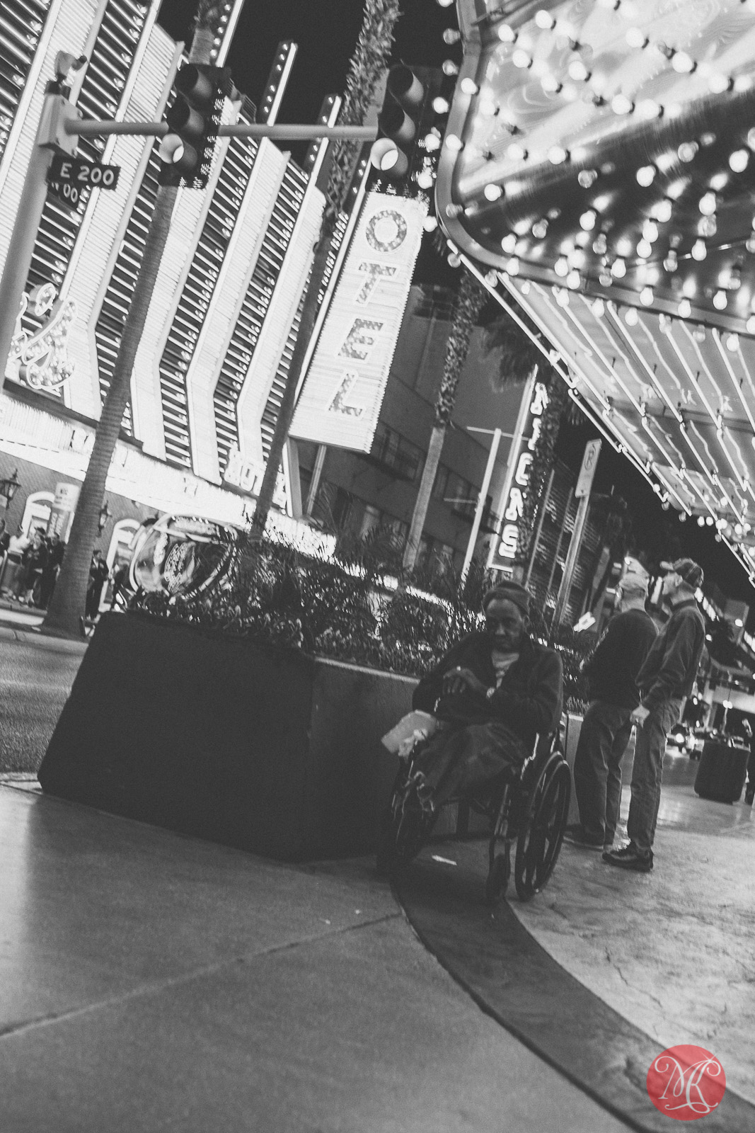 freemont street las vegas a homeless disabled man sitting under a marquee