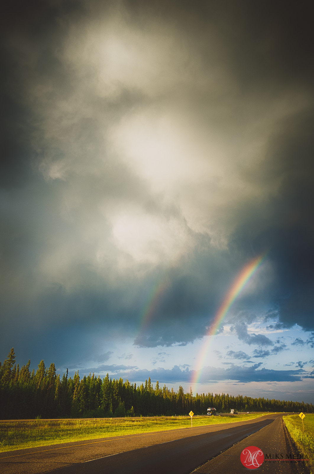 23 highway storm clouds and rainbow.jpg