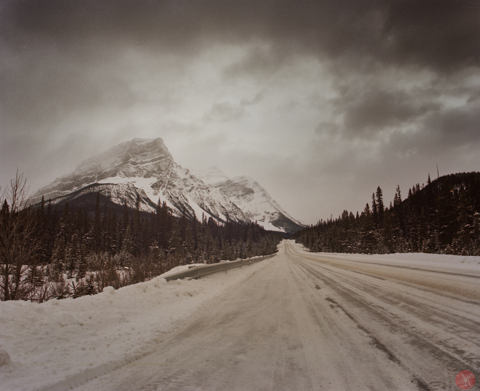 Empty snowy road in the Alberta Rockies