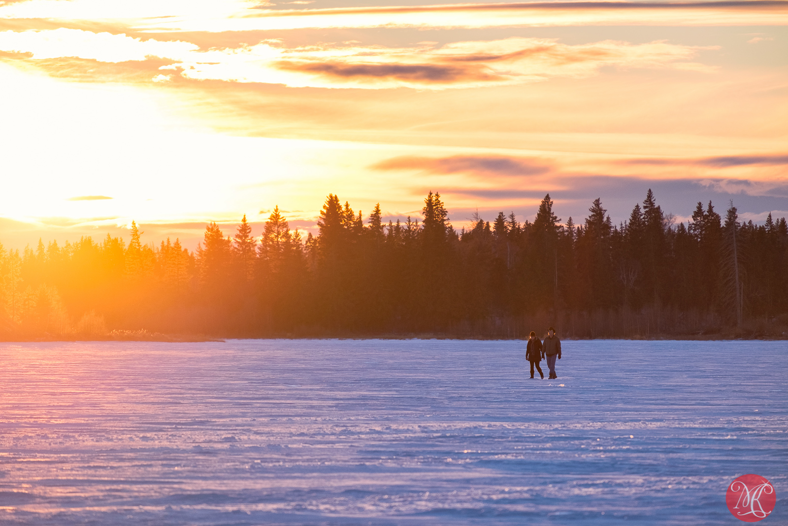 Sunset walk on the frozen lake