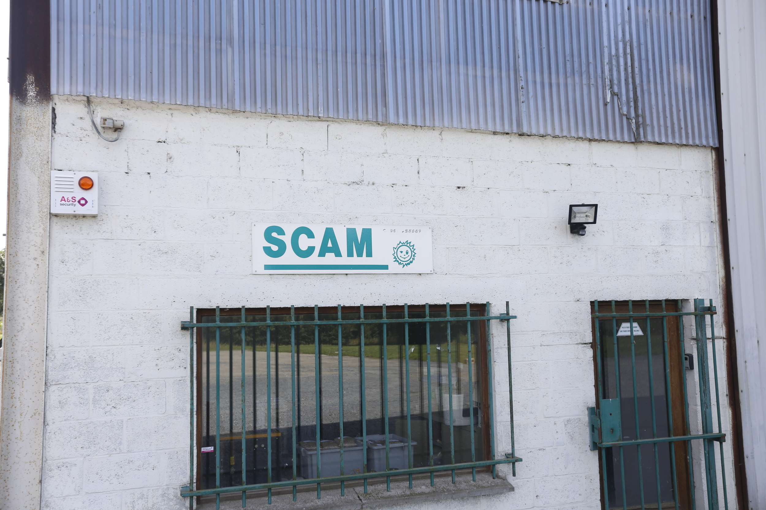 """"""" SCAM """", not the best name for a business...I particularly liked the winky face next to the name!"""