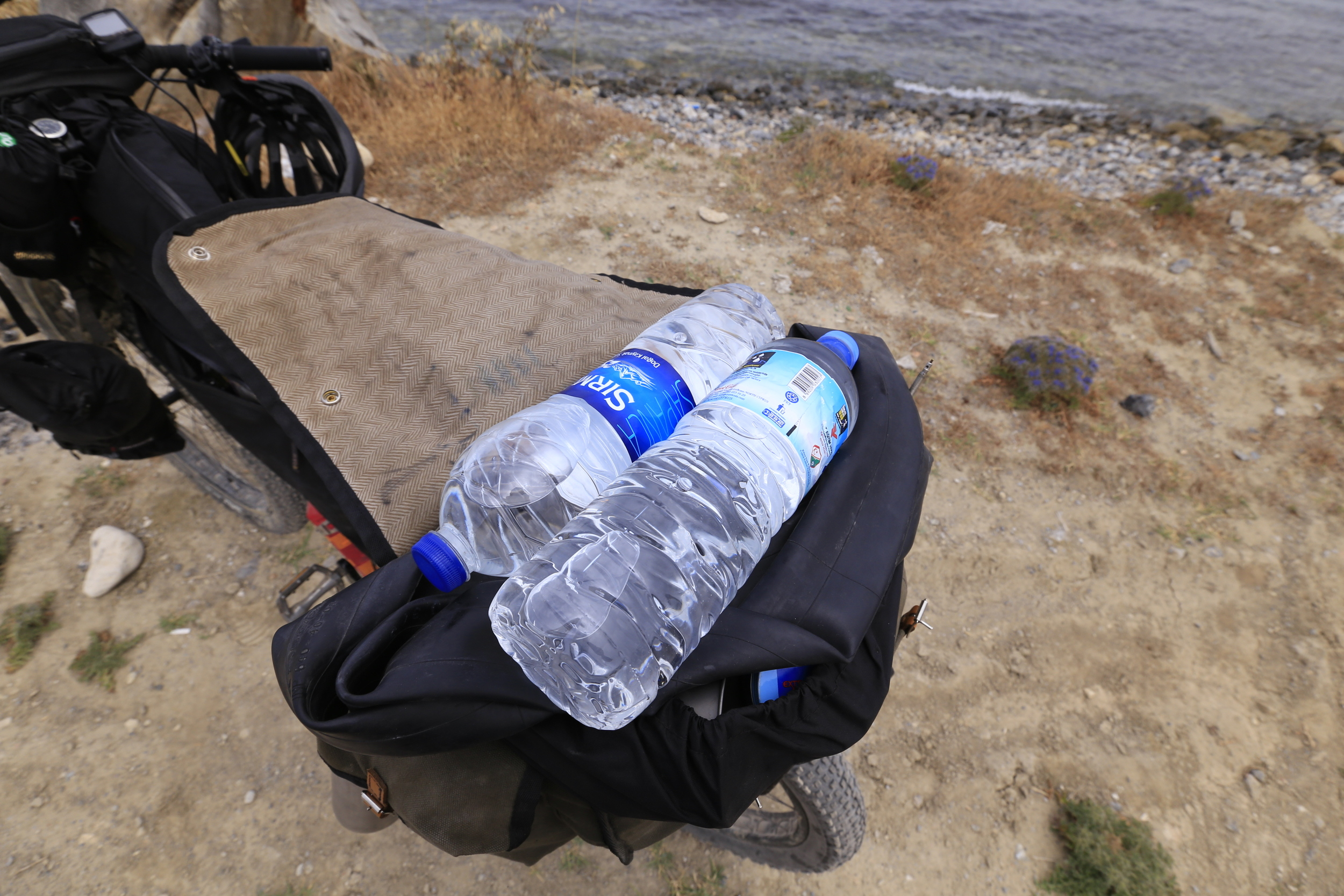 The Longflap's adjustable straps allowed me to carry a pair of additional two litre water bottles on top of all my gear.