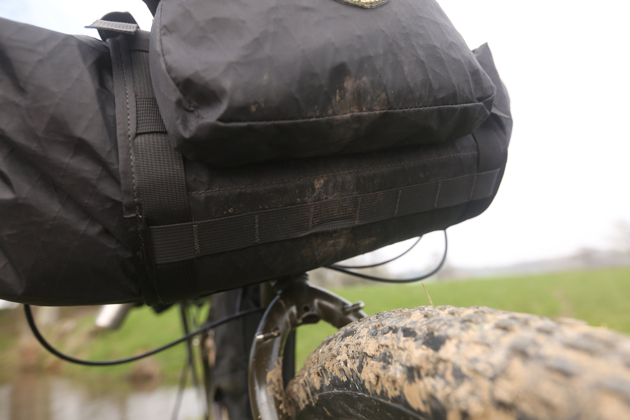 The Handee Randee also features daisy chain webbing on the bottom of the bag ( this would be a great way to secure the base to a front rack ).