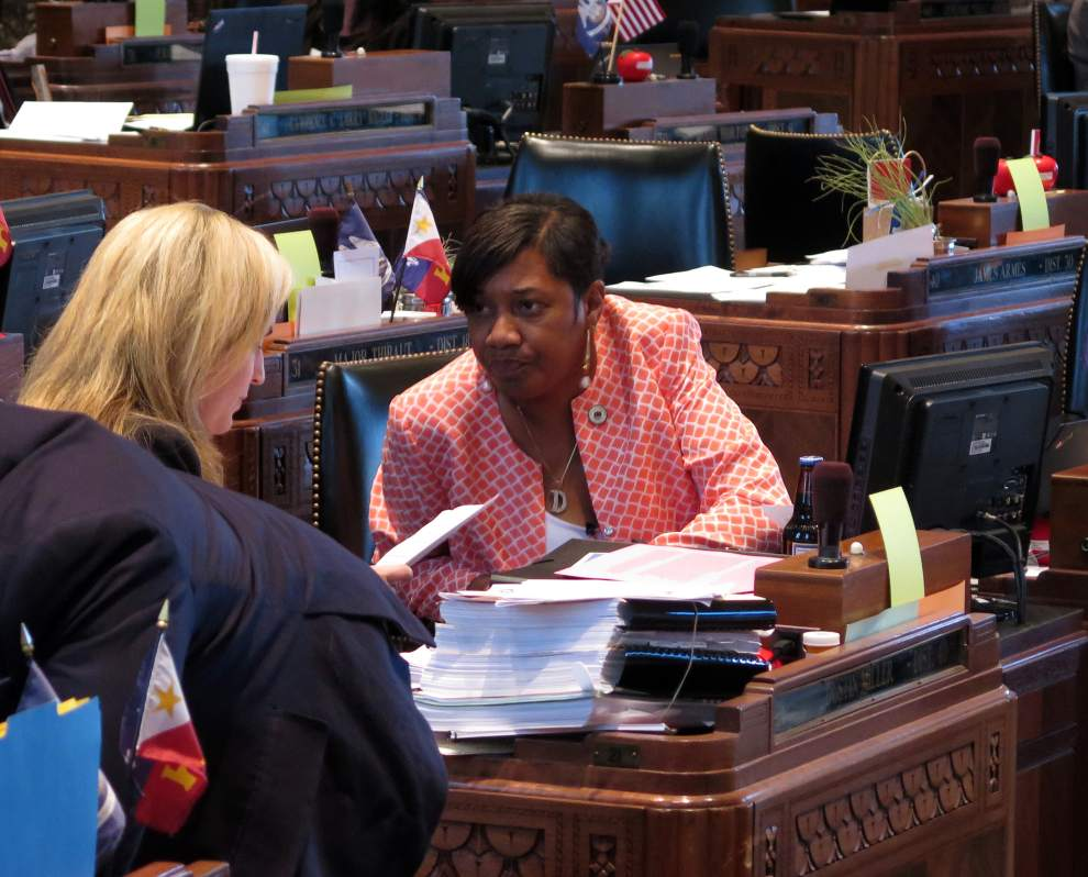 Advocate Photo by MARK BALLARD -- State Rep. C. Denise Marcelle, D-Baton Rouge, prepares Tuesday to present legislation to the Louisiana House that would give ex-convicts a better chance at landing a job interview with the state.