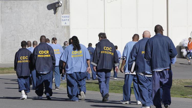Inmates walk through the exercise yard at California State Prison Sacramento, near Folsom, Calif. (Rich Pedroncelli / Associated Press)