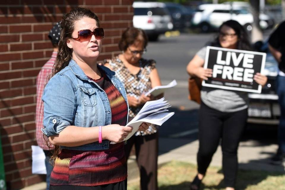 Victoria Castillo, the organizer of Merced Organizing Project's Live Free campaign, speaks to a crowd gathered outside the Merced County Sheriff's Office in August to discuss a report. Thaddeus Miller tmiller@mercedsunstar.com