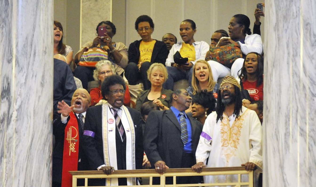 Chanting for the Missouri Senate to approve Medicaid expansion, members of the Missouri Faith Voices and a number of faith communities gathered supporters at the Capitol in Jefferson City, MO (AP Photo / The Jefferson City News-Tribune, Julie Smith)