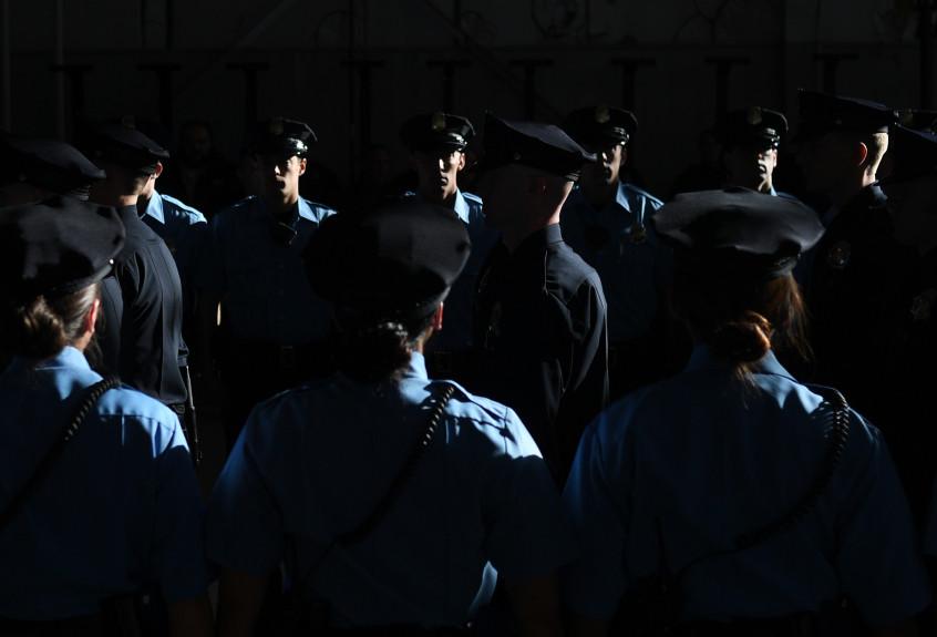 Police recruits walk in for their graduation at Denver Police Academy training facility, Jan. 6, 2017. RJ Sangosti, The Denver Pos