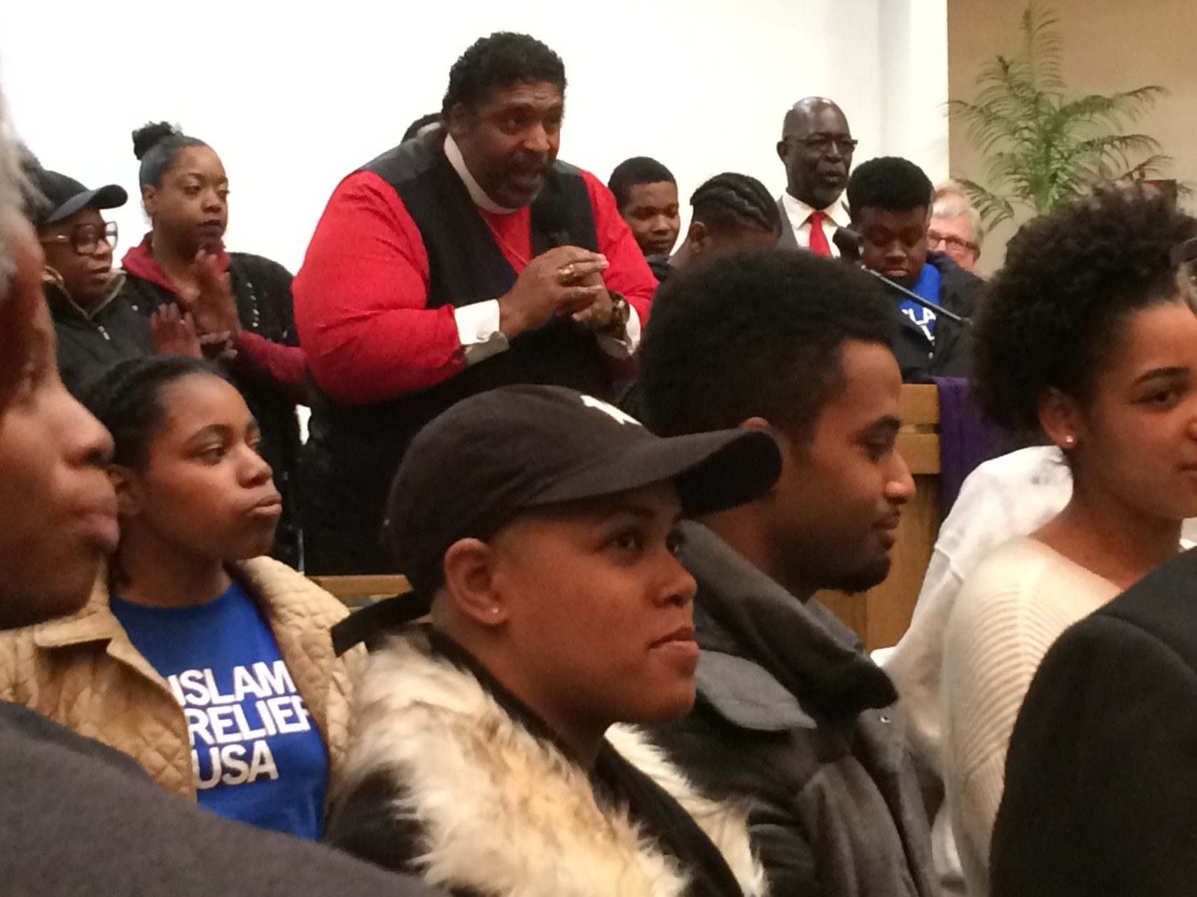 """Barber surrounded by what he called """"New Salt"""" and """"Old Salt"""" at Grace Emmanuel Church Monday night. (Photo by Jan Worth-Nelson)"""