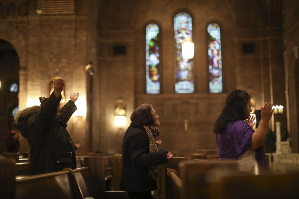 Jeff Wheeler – Star Tribune. Worshipers prayed during the Thursday night mass in Spanish at Church of the Incarnation in Minneapolis. A church member was arrested in the recent sweep as he dropped off his son with a caregiver.