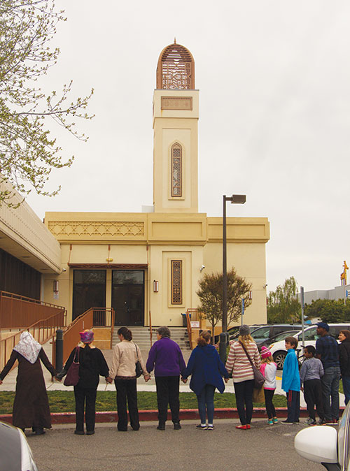 hands-around-the-mosque-celebrates-unity-denounces-division.jpg