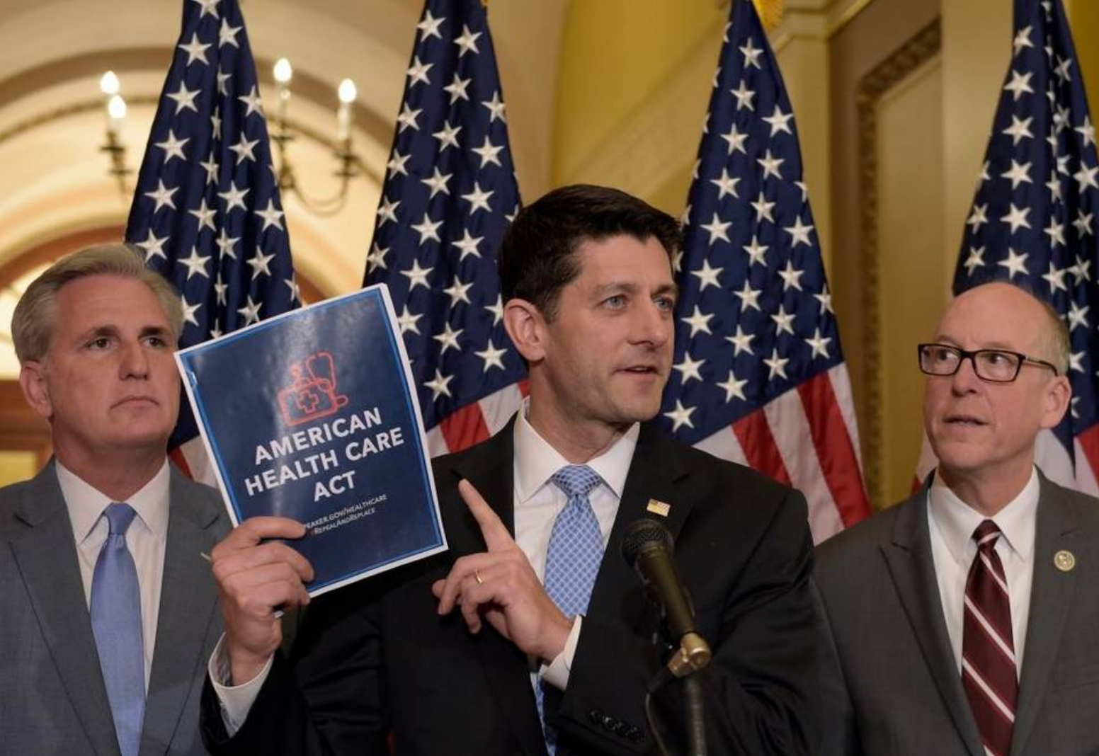 House Speaker Paul Ryan of Wisconsin, center, standing with Energy and Commerce Committee Chairman Greg Walden, R-Ore., right, and House Majority Whip Kevin McCarthy, R-Bakersfield, left, speaks during a news conference on the American Health Care Act on Capitol Hill in Washington March 7, 2017. Susan Walsh AP