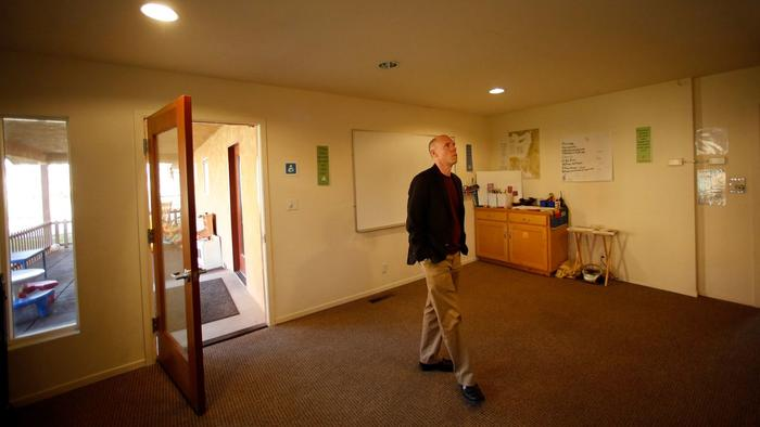 The Rev. Tim Kutzmark of the Unitarian Universalist Church of Fresno walks through a room at the church that will be offered as sanctuary to an undocumented individual or family if members approve. (Genaro Molina / Los Angeles Times) (Genaro Molina / Los Angeles Times)