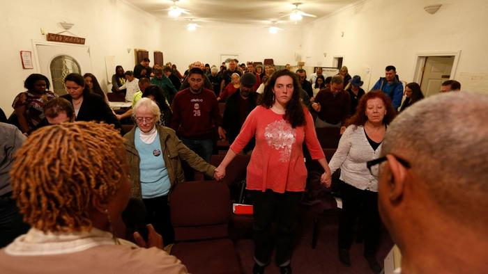 Participants join hands and sing a hymn to close a training session at Rising Star Missionary Baptist Church in Fresno for religious leaders and community members who wish to support immigrants facing deportation. (Genaro Molina / Los Angeles Times) (Genaro Molina / Los Angeles Times)
