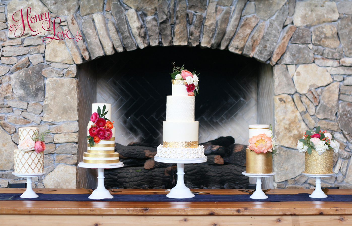 A multi-cake display is a beautiful alternative to one big wedding cake when you need to serve a large crowd.