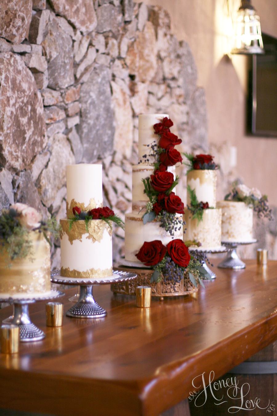 Multi-cake display to serve 150 wedding guests.