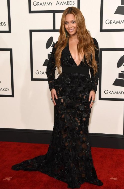 Beyoncé opted for wavy locks with a black, mesh inset gown with gorgeous embellishments. However, her hair choice could have been a little more prim and proper for the event. A pony would've brought the look together a bit more.  *Lola's Notes*: I actually like her hair down, but I would have opted for an up-do of a sort. There's a lot going on in the dress, so it would have been a chic option.