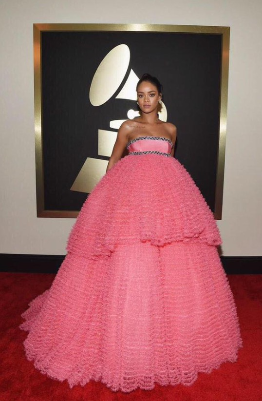 Rihanna was pretty in pink, perhaps a bit too much emphasis on pretty and sweet, as the look reminds us of a Quinceñeara dress. The makeup artist delivered elegance, but the tulle overload on the dress left  too  much to be desired.    *Lola's Notes:* FLASH BACK TO MY QUINCE circa 2007