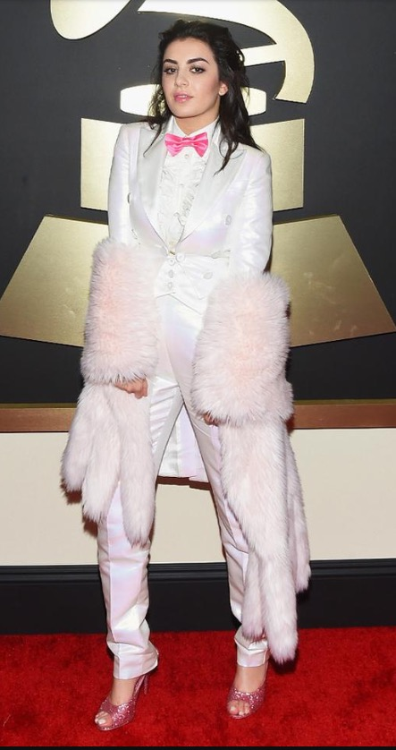 Charlie Xcx kept things fun and light with a baby pink bowtie and fur stole in all white by Moschino.   Staying true to her roots is what gets Charlie an A+!      **Lola's notes** Peep the pink pumps! I wonder if we wear the same size. hehe
